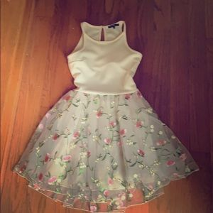 Girls Cream dress with pink and green flowers.